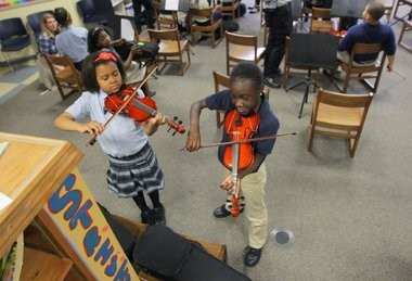 University Heights Charter School students Maniya Kemp-Smith 10, and Ajanay Hall, 9, practice violin after school as part of a pilot program between the Newark school and the New Jersey Symphony Orchestra.