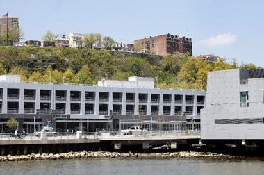 The parking garage under construction at the Port Imperial Ferry Terminal in Weehawken would serve as the paddock area for Formula 1 race teams competing in the Grand Prix of America, now scheduled for June 2014 after being postponed for a year.
