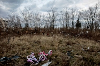 Children's bikes lay abandoned in a field littered with clothing and other debris off Brook Avenue in Union Beach in this November file photo.