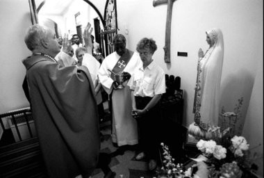 The Rev. John Nickas, left, blesses a new chapel at St. Rocco's Church in Newark in this 1996 file photo.