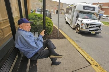 Walter Kucharski, 71, of South River, waits for the next Middlesex County Area Transit Shuttle at Brunswick Square Mall. Funding for the shuttles, which serve seniors and the disabled, has been cut for five straight years due to less money being brought in at Atlantic City casinos.