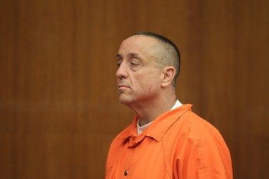 The Rev. Michael Fugee listens in court Tuesday as a prosecutor reads the charges against him.