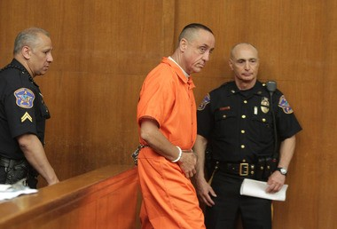The Rev. Michael Fugee walks into court in May after his arrest on charges of violating a judicial order.