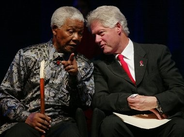 Nelson Mandela and former President Bill Clinton share a moment during the International AIDS Conference in Barcelona, Spain, in 2002.