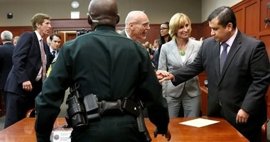 George Zimmerman is congratulated by his defense team, including Mark O'Mara, far left, Don West, center, and Lorna Truett, after being found not guilty, on the 25th day of his trial at the Seminole County Criminal Justice Center, in Sanford, Florida.