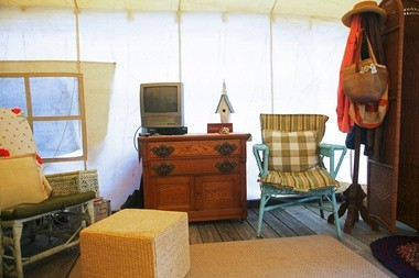 The cozy, sun-splashed interior of an Ocean Grove tent.