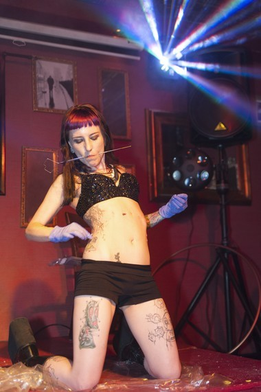 Sideshow performer and burlesque dancer, Gisella Rose organizes variety shows called ScarLit ArtEsque at Hell's Kitchen in Newark.