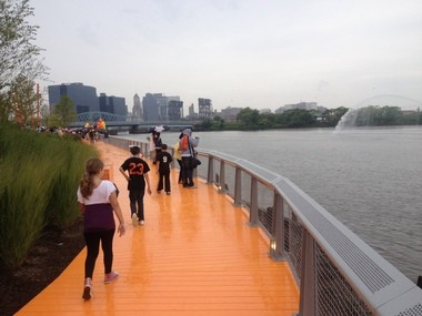One of the Riverfront Park's signatures is a bright orange boardwalk.
