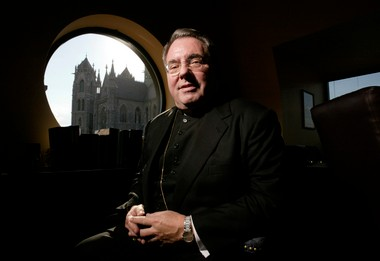 Archbishop John J. Myers is seen in his office in this 2005 file photo.