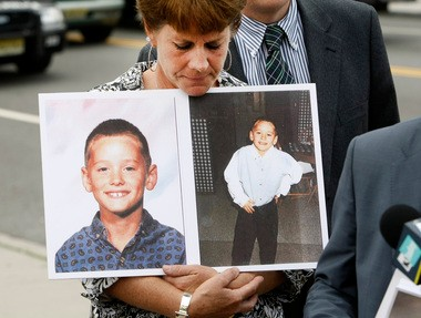 Joanne Ward displays photos of her son Andrew, who was 8 when he was allegedly molested by the Rev. Thomas Maloney in the Diocese of Peoria. At an Aug. 13 press conference in Newark, the mother blamed former Peoria Bishop John J. Myers, now archbishop of Newark, for failing to remove Maloney from ministry.