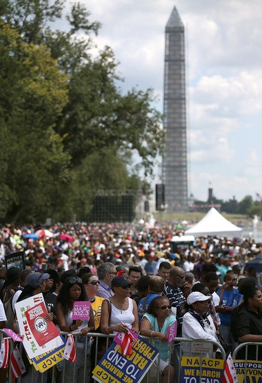 "People gather at the Washington Monument on the 50th anniversary of Martin Luther King Jr.'s ""I Have a Dream"" speech."
