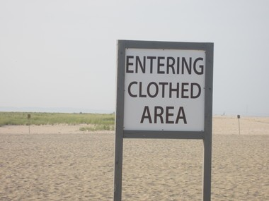 There are also signs warning nude sunbathers about clothed areas.