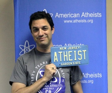 American Atheists president David Silverman with an old New Jersey license plate.