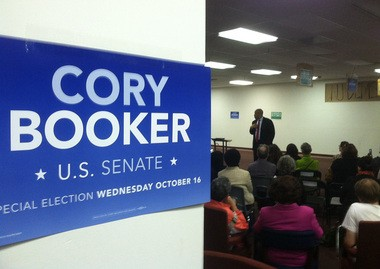 Cory Booker addresses a room of volunteers at an event in New Brunswick.