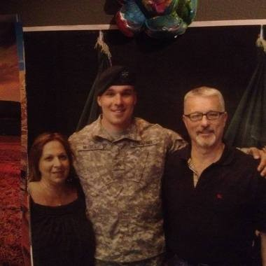 Army Staff Sgt. Timothy Raymond McGill, pictured here with his parents, Carol and Raymond McGill, was killed in Afghanistan on Saturday.