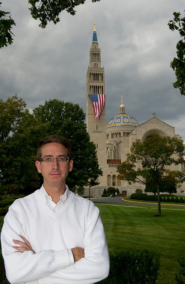 Timothy Schmalz, 23, stands before the Basilica of the National Shrine of the Immaculate Conception in Washington D.C. Schmalz, originally from Howell, was an altar server at the shrine when he met the Rev. Matthew Riedlinger, who has since been removed from ministry in the Diocese of Trenton.