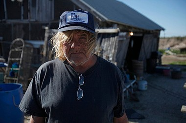 Commercial fisherman Bob Bateman standing outside his work shop behind his house in Bivalve. Bateman's property continues to flood during full moon high tides because of a breach in the bank of the Maurice River about a half mile away. Bateman had four feet of water in his home during Hurricane Sandy.