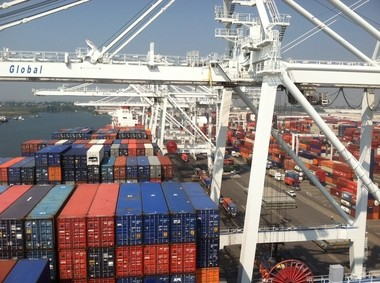 The Waterfront Commission of New York Harbor has rejected assertions in a suit by union dockworkers and their employers that is improperly interfering with the hiring of dockworkers. A ship was unloaded earlier this year at the Global Container Terminal on the Jersey City-Bayonne Border.