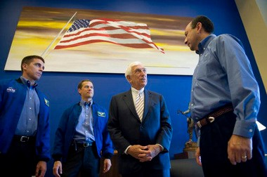 """Sen. Frank Lautenberg with the crew of the Space Shuttle Endeavor in his Senate office in 2009. In the background is Ed Ruscha's """"Untitled,"""" from 1985. Lautenberg bought the painting in 1986. It sold at Christie's New York last night for nearly $4.2 million as part of the auction house's sale of the late senator's art collection."""