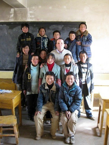The Rev. Ray Leonard poses with some of his students in an impoverished region of Qinghai Province, China.
