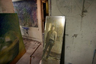A grimy mirror in his studio, in a basement in Gloucester, Mass., provides Jon Sarkin with an image on which to base one of his many self-portraits as he charts his own evolution. (Photo by Jennifer Brown/The Star-Ledger)