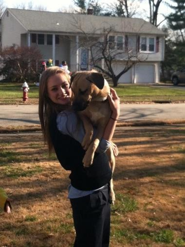 Rachel Canning poses with one of her dogs on the front lawn of her Lincoln Park home.