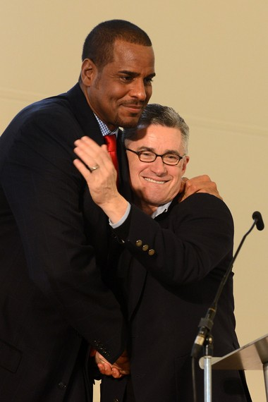 Former NBA star Jayson Williams, who did prison time in connection with the fatal 2002 shooting of his chauffeur and an unrelated drunk driving charge, hugs former Gov. Jim McGreevey after speaking at the Prisoner Reentry Conference at St. Peter's University in Jersey City