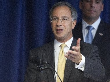 New Jersey U.S. Attorney Paul Fishman announces the arrests of 14 people for their role in one of the nation's largest and longest-running tax refund fraud schemes at a 2012 press conference.