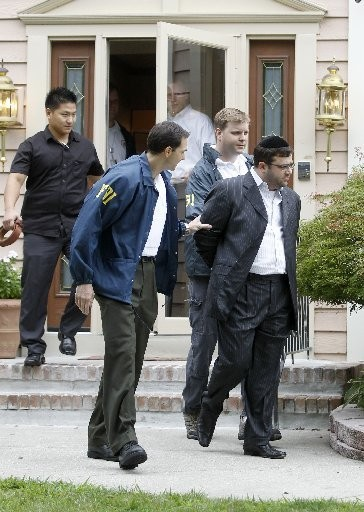 Eliyahu Weinstein was led out of his Lakewood home by FBI agents in 2010.