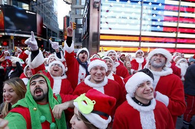 SantaCon 2014 began in Times Square and moved on to various bars in Midtown Manhattan. Organizers discouraged the Santas from lingering in the street, acknowledging the wishes of police and a nearby protest. (Aristide Economopoulos | NJ Advance Media for NJ.com)
