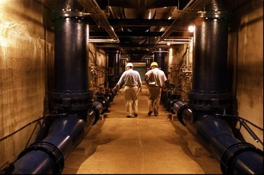In this 1996 file photo, workers walk through a tunnel at the Passaic Valley Water Commission's treatment plant in Totowa. The tunnel is similar to the one where Geetha Angara disappeared in 2005. Her body was later found in an underground tank.