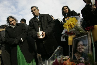 On the one-year anniversary of Geetha Angara's death, mourners attend a candlelight vigil at the entrance to the Passaic Valley Water Commission's treatment plant in Totowa. Angara's 2005 death at the facility remains unsolved. The slain chemist's husband, Jaya Angara, is seen second from left. (File photo)