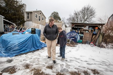 Surrounded by their belongings, Jen Toole stands on their lot with her 9-year-old son, Trent, on Wednesday. (Andrew Mills | NJ Advance Media for NJ.com)