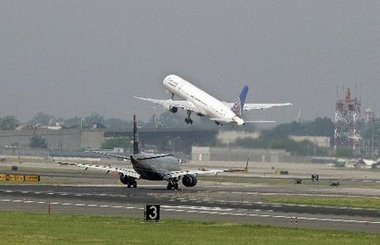 A Delta flight was delayed for several hours Friday after Jerry Speziale, the former assistant public safety director of the Port Authority Police Department, had a dispute over his carry-on luggage, a law enforcement official said. File photo of an airplane taking off.
