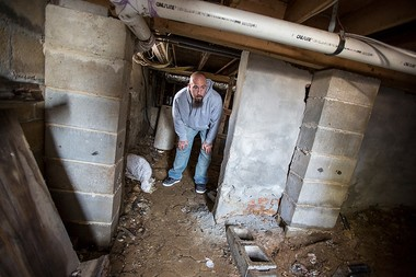 Rob Buck shows off the damage beneath his Long Branch home he claims was caused by a shoddy RREM contractor. Buck says he repaired all the Sandy damage himself, only to be told by local officials told he still had to raise it.