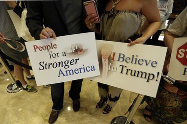 Supporters of developer Donald Trump wait for his announcement that he will seek the Republican nomination for president, Tuesday, June 16, 2015, in the lobby of Trump Tower in New York.