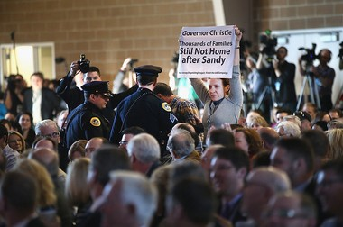 Hurricane Sandy victim Amanda Devecka-Rinear from Stafford Township interrupts Chris Christie at the Iowa Ag Summit on March 7, 2015 in Des Moines, Iowa.