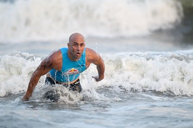 Sea Girt's Mike Barrows emerges from the surf as he helps the smallMonmouth County borough win the $5,000 grand prize Tuesday night in Atlantic City.