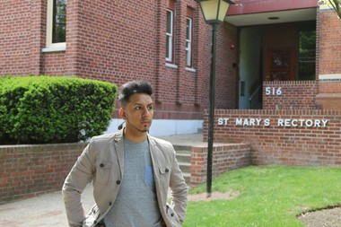 Max Rojas Ramirez, 28, stands outside the rectory of St. Mary's Church in Plainfield. It was his first visit there since he was 15, when he told others he was raped in the rectory by the Rev. Manuel Gallo Espinoza. Gallo Espinoza fled the country after the claim was reported to police, church officials say. (Mark Mueller | NJ Advance Media for NJ.com)