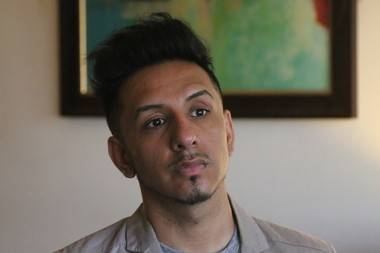 Max Rojas Ramirez, 28, seen here in his Elizabeth apartment, filed suit against the Archdiocese of Newark earlier this year. (Mark Mueller | NJ Advance Media for NJ.com)