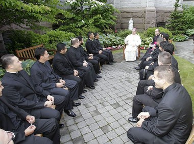 The Rev. Alex Orozco, at bottom left, was one of 16 seminarians ordained in 2012. The new priests chat with Newark Archbishop John J. Myers on the day of their ordination. Orozco is now under investigation by the Essex County Prosecutor's Office. (Star-Ledger file photo)