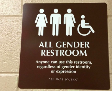 In this 2014 file photo, a sign for an all-gender restroom at Rowan University is pictured. This is one of several gender neutral restrooms that have been constructed at the South Jersey college. (Brittany M. Wehner | South Jersey Times)