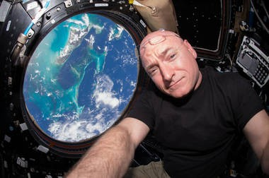 Scott Kelly is seen inside the Cupola, a special module which provides a 360-degree viewing of the Earth and the space station, on July 12, 2015.