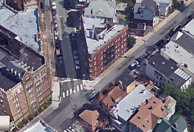 A Google Earth view of 6 Tonnele Ave., the triangularbuilding at center. Jersey City police cleared a group of celebrating Muslims from the roof on 9/11, a retired captain says.