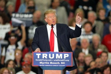 """Donald Trump, seen here at a campaign rally in Myrtle Beach, S.C., claimed on Nov. 21 that """"thousands and thousands"""" of Muslims celebrated in Jersey City on 9/11. Witnesses have told NJ Advance Media they saw small pockets of celebration, but Trump's broad claim is baseless. (AP Photo/Willis Glassgow)"""