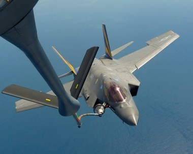 An F-35C is shown refueling in air.
