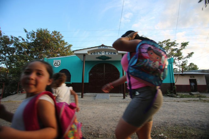 A family walks by Iglesia Eben-Ezer, an Assemblies of God church in Esteli, Nicaragua. Gregorio Martinez, who fled New Jersey after a conviction on child molestation charges, lived here for about seven months, according to the pastor and others. (Brian Donohue | NJ Advance Media for NJ.com)