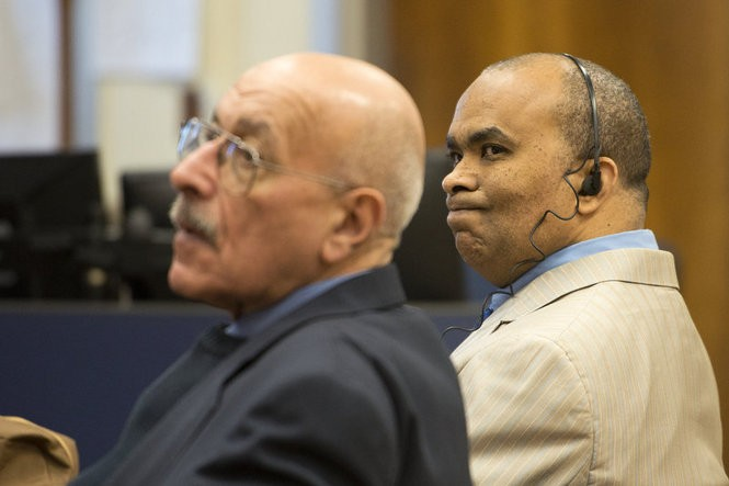 Defense lawyer Louis Serterides, left, represented Martinez at trial in February 2015. Martinez, right, is wearing headphones to listen to a Spanish-language interpreter. (Reena Rose Sibayan | The Jersey Journal)