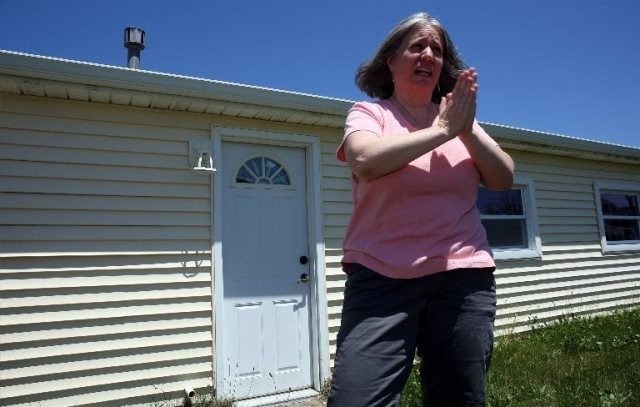 Laurie Fox stands outside her Forked River Beach home, which was destroyed by Hurricane Sandy.
