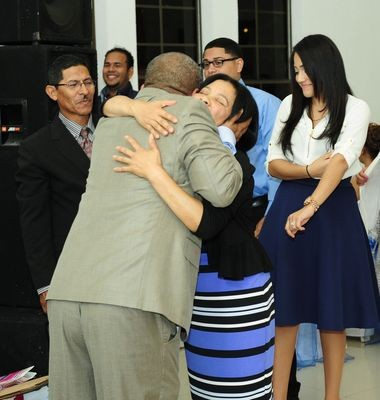 Gregorio Martinez embraces Paula Martinez, no relation, at his birthday party in Esteli, Nicaragua, in November. Paula Martinez had denied knowing the fugitive molester's whereabouts.